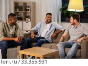 Купить «happy male friends talking at home at night», фото № 33355931, снято 28 декабря 2019 г. (c) Syda Productions / Фотобанк Лори