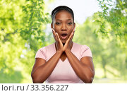 shocked african american woman with open mouth. Стоковое фото, фотограф Syda Productions / Фотобанк Лори