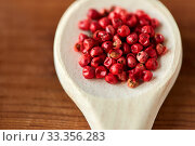 Купить «close up of pink peppercorns on wooden spoon», фото № 33356283, снято 6 сентября 2018 г. (c) Syda Productions / Фотобанк Лори