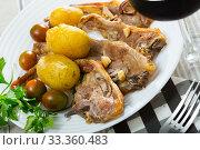 Купить «Roasted lamb ribs with potato», фото № 33360483, снято 31 марта 2020 г. (c) Яков Филимонов / Фотобанк Лори