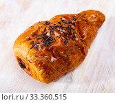 Купить «Chocolate snail croissant, french dessert at wooden surface», фото № 33360515, снято 25 мая 2020 г. (c) Яков Филимонов / Фотобанк Лори