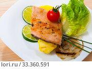 Купить «Tasty fried trout fillets served with cherry tomatoes, potatoes,onion and greens», фото № 33360591, снято 4 августа 2020 г. (c) Яков Филимонов / Фотобанк Лори