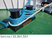 Купить «Powerful bollard on the ship fore deck is tied with white and blue nylon ropes», фото № 33361551, снято 19 марта 2019 г. (c) Олег Белов / Фотобанк Лори