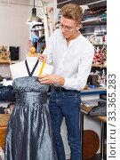 Dressmaker using tape measure. Стоковое фото, фотограф Яков Филимонов / Фотобанк Лори