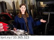 Купить «Young female standing with notepad in production workshop», фото № 33365323, снято 12 июля 2020 г. (c) Яков Филимонов / Фотобанк Лори