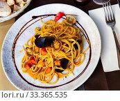 Купить «Italian spaghetti al Frutti di Mare», фото № 33365535, снято 30 марта 2020 г. (c) Яков Филимонов / Фотобанк Лори