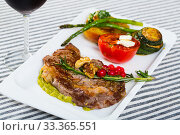Купить «Photography of plate with baked veal with vegetables», фото № 33365551, снято 27 июня 2018 г. (c) Яков Филимонов / Фотобанк Лори