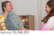 Купить «happy teenage having pillows fight at home», видеоролик № 33366251, снято 18 января 2020 г. (c) Syda Productions / Фотобанк Лори