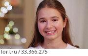 Купить «portrait of happy teenage girl at home», видеоролик № 33366275, снято 18 января 2020 г. (c) Syda Productions / Фотобанк Лори