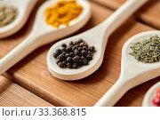 Купить «spoons with different spices on wooden table», фото № 33368815, снято 6 сентября 2018 г. (c) Syda Productions / Фотобанк Лори