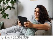 Купить «woman with tablet pc computer on sofa at home», фото № 33368939, снято 9 февраля 2020 г. (c) Syda Productions / Фотобанк Лори