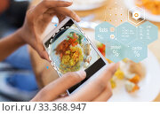 Купить «hands with phone and food nutritional value chart», фото № 33368947, снято 2 мая 2017 г. (c) Syda Productions / Фотобанк Лори