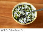 close up of flavored sea salt in bowl with spoon. Стоковое фото, фотограф Syda Productions / Фотобанк Лори