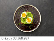 toast bread with mashed avocado and eggs. Стоковое фото, фотограф Syda Productions / Фотобанк Лори