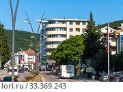 Купить «Budva, Montenegro - June 10. 2019. Adriatic highway - the main street in the city», фото № 33369243, снято 10 июня 2019 г. (c) Володина Ольга / Фотобанк Лори