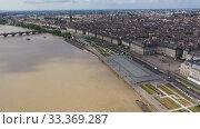 Купить «Day aerial cityscape of Bordeaux city and Garonne river in France», видеоролик № 33369287, снято 18 июля 2019 г. (c) Яков Филимонов / Фотобанк Лори
