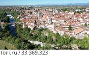 Picturesque aerial view of historic centre of Cividale del Friuli with Cathedral of Santa Maria Assunta on sunny autumn day, Italy (2019 год). Стоковое видео, видеограф Яков Филимонов / Фотобанк Лори