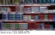 Купить «Shelves with toothpaste in the supermarket», видеоролик № 33369675, снято 7 ноября 2019 г. (c) Яков Филимонов / Фотобанк Лори
