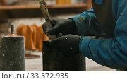 Купить «Concrete industry - a man working with a chisel to clean up the form», видеоролик № 33372935, снято 5 июня 2020 г. (c) Константин Шишкин / Фотобанк Лори