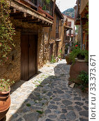 Купить «The narrow stone paved street of the old Kakopetria. Nicosia District. Cyprus», фото № 33373671, снято 11 июня 2018 г. (c) Serg Zastavkin / Фотобанк Лори