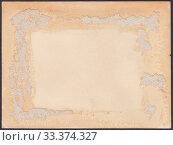 Купить «Оборотная сторона старой фотографии, испачканная засохшим клеем и остатками оторванной бумаги», иллюстрация № 33374327 (c) александр афанасьев / Фотобанк Лори