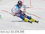 Russian Federation Alpine Skiing Championship, parallel slalom. Sportswoman mountain skier Anna Vakhnina Krasnoyarsk skiing down mountain slope (2019 год). Редакционное фото, фотограф А. А. Пирагис / Фотобанк Лори
