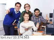 Купить «Students reading textbook in classroom», фото № 33374563, снято 14 ноября 2018 г. (c) Яков Филимонов / Фотобанк Лори