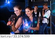 Купить «Two girls posing with laser guns», фото № 33374599, снято 27 августа 2018 г. (c) Яков Филимонов / Фотобанк Лори