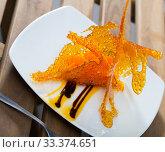 Купить «Tasty dessert of sweet carrots cubes with caramel and vanilla sauce», фото № 33374651, снято 9 апреля 2020 г. (c) Яков Филимонов / Фотобанк Лори