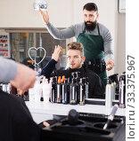 Купить «Client looking displeased about new haircut», фото № 33375967, снято 27 января 2017 г. (c) Яков Филимонов / Фотобанк Лори