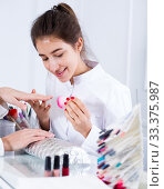 Купить «Woman doing manicure», фото № 33375987, снято 2 февраля 2017 г. (c) Яков Филимонов / Фотобанк Лори