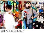 Купить «Couple deciding on climbing equipment», фото № 33376007, снято 24 февраля 2017 г. (c) Яков Филимонов / Фотобанк Лори