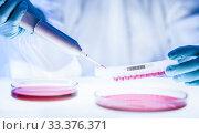 Купить «Detail of scientist working in the corona virus vaccine development laboratory research with a highest degree of protection gear.», фото № 33376371, снято 13 июля 2020 г. (c) Matej Kastelic / Фотобанк Лори