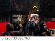 Купить «Radical students of the Universidad Nacional de Colombia attach a poster to a bus window during a protest march against government's policies and corruption...», фото № 33380763, снято 24 октября 2019 г. (c) age Fotostock / Фотобанк Лори