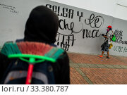 Купить «A radical student of the Universidad Nacional de Colombia paints a political slogan on the wall during a protest march against government's policies and...», фото № 33380787, снято 24 октября 2019 г. (c) age Fotostock / Фотобанк Лори