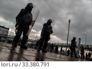 Купить «Colombian riot control policemen guard in front of the Universidad Nacional de Colombia during a protest march against government's policies and corruption...», фото № 33380791, снято 24 октября 2019 г. (c) age Fotostock / Фотобанк Лори