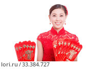 Купить «Young asian woman in red cheongsam holds red envelope in chinese new year», фото № 33384727, снято 14 июля 2020 г. (c) age Fotostock / Фотобанк Лори