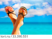 Купить «Woman feet crossed with paradise island on background», фото № 33390551, снято 4 июля 2020 г. (c) easy Fotostock / Фотобанк Лори