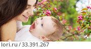 Купить «mother with baby over spring garden background», фото № 33391267, снято 22 декабря 2007 г. (c) Syda Productions / Фотобанк Лори