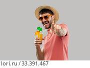 Купить «happy man in straw hat with orange juice cocktail», фото № 33391467, снято 22 февраля 2020 г. (c) Syda Productions / Фотобанк Лори