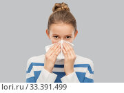 sick teenage girl blowing nose with paper tissue. Стоковое фото, фотограф Syda Productions / Фотобанк Лори