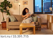 Купить «unhappy woman suffering from pain in hand at home», фото № 33391715, снято 9 февраля 2020 г. (c) Syda Productions / Фотобанк Лори