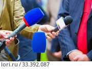the hands of journalists hold microphones for an interview at a city festival in the park. Стоковое фото, фотограф Акиньшин Владимир / Фотобанк Лори