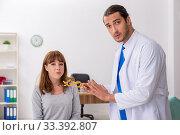 Купить «Young woman visiting male doctor oculist», фото № 33392807, снято 11 сентября 2019 г. (c) Elnur / Фотобанк Лори