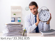 Купить «Young male businessman employee unhappy with excessive work», фото № 33392835, снято 10 сентября 2019 г. (c) Elnur / Фотобанк Лори