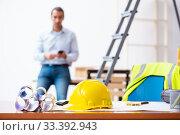 Купить «Young male architect working indoors», фото № 33392943, снято 5 сентября 2019 г. (c) Elnur / Фотобанк Лори