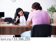 Купить «Young man consulting with judge on litigation issue», фото № 33396255, снято 6 мая 2019 г. (c) Elnur / Фотобанк Лори