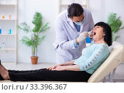 Old woman visiting young doctor dentist. Стоковое фото, фотограф Elnur / Фотобанк Лори