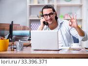 Купить «Young male designer working in the office», фото № 33396371, снято 4 апреля 2019 г. (c) Elnur / Фотобанк Лори