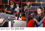 Laughing boy and girl posing with laser guns. Стоковое фото, фотограф Яков Филимонов / Фотобанк Лори